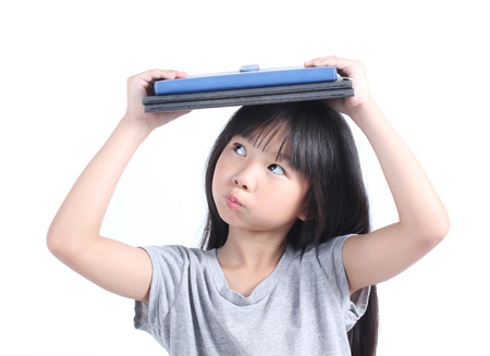 kid book: Portrait of young girl with book Stock Photo