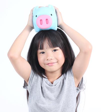 asian children: Young girl holding piggy bank Stock Photo