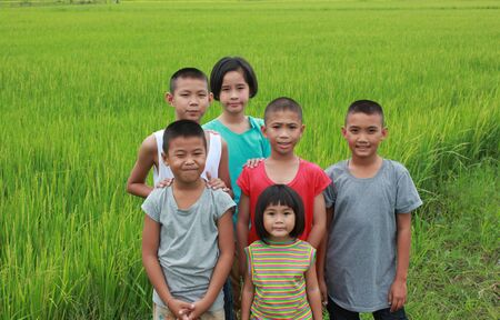 child smile: Six  asian boys in the rice field.