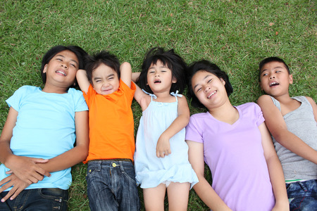 child smile: Five kids having good time in the park.