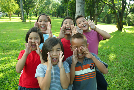 hide and seek: Six kids having good time in the park.