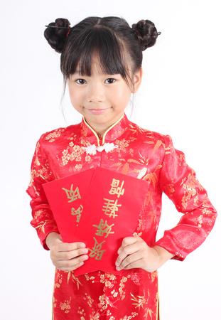 niñas chinas: Linda chica llevaba traje rojo chino Foto de archivo