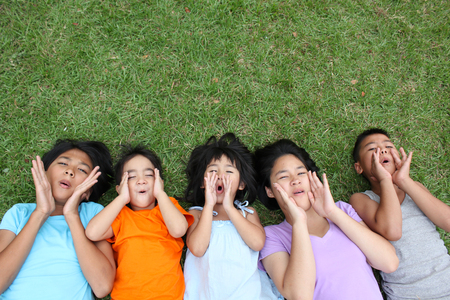 study group: Five kids having good time in the park.