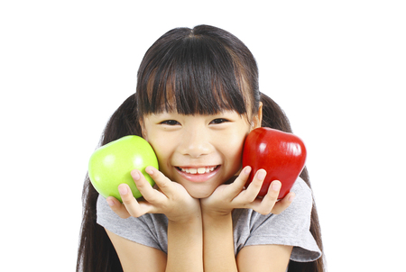 hungry kid: Cute girl holding red and green apple Stock Photo