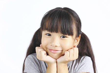 young asian: Portrait of young asian girl on white background. Stock Photo