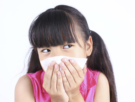 blows: Little girl blows her nose