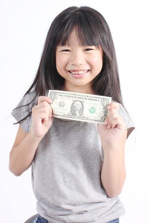 little one: Cute girl holding money