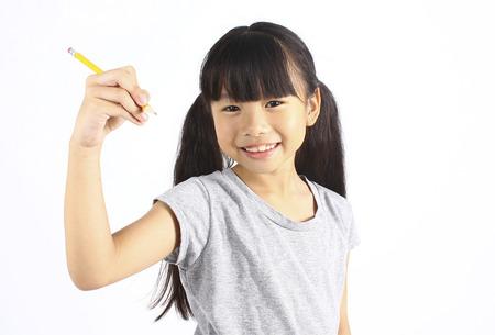 school activities: Happy girl with pencil Stock Photo