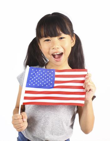 アメリカの国旗を保持しているかわいい女の子 写真素材 - 52379974