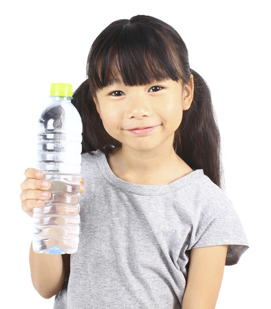 hold on: Young little girl holding a bottle of water.
