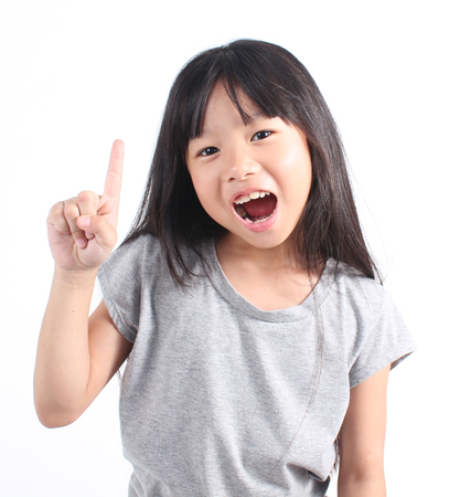 asian preteen: Little girl with her two finger Stock Photo