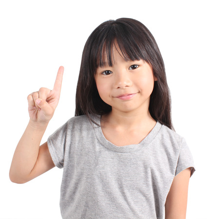 Little girl with her two finger Standard-Bild