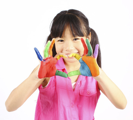 Funny little girl with hands painted in colorful paint