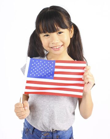 asian children: Cute girl holding an American Flag Stock Photo
