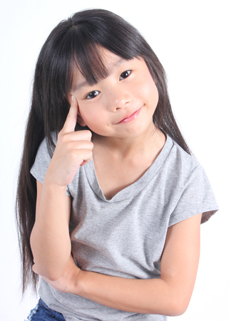 asian children: Portrait of young cute girl isolated on white background.