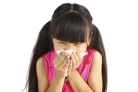 blows: Little girl blows her nose, isolated over white