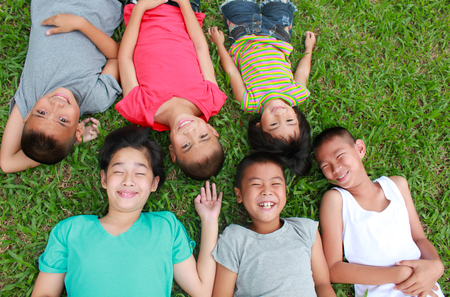 asian children: Six children playing in the park, spring time.