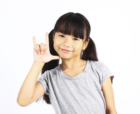 heart in hand: Asian girl show love sign hand on white background Stock Photo