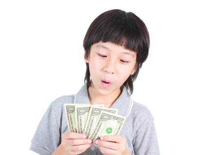 Young boy holding money