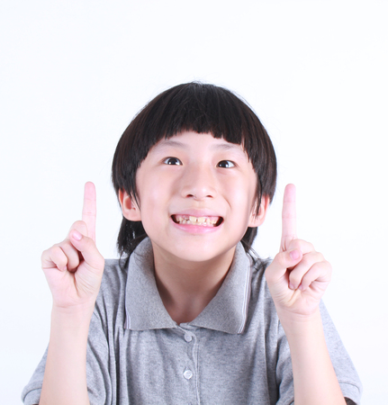 asian boy: Little boy portrait close up face on white background Stock Photo