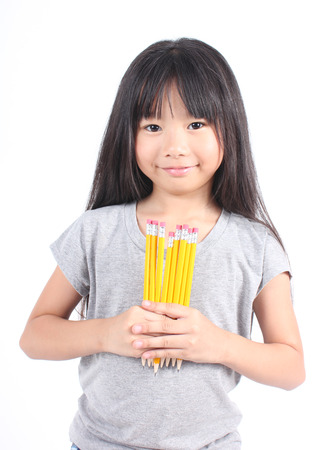 Young girl holding yellow pencils