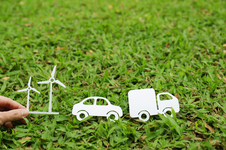 hand paper: Paper cut of truck car and windmill on green grass Stock Photo