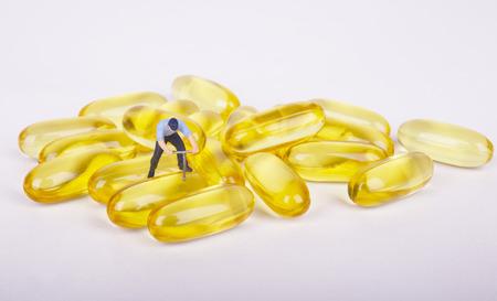 miniature: Miniature people working people posting with medicine