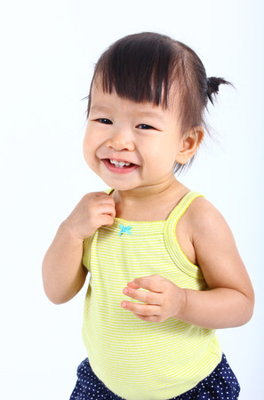 blue background: Portrait of little cute asian baby on a white background