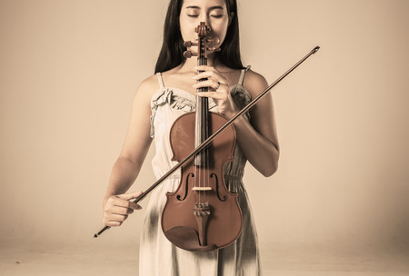 beautiful young asian woman playing violin Stock Photo