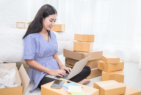 Start up small business entrepreneur SME or freelance woman working at home concept, Young Asian small business owner at home office, on line marketing packaging and delivery, SME concept Stock Photo - 84636556