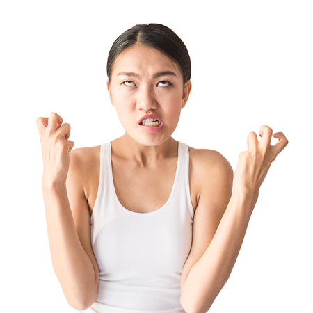 portrait of angry pensive mad crazy woman screaming out (expression, facial), beauty portrait of young asian woman isolated on white background.