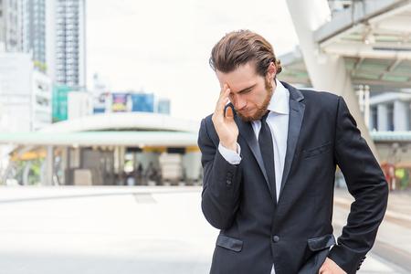 portrait stressed sad business man outdoors. City urban life style stress