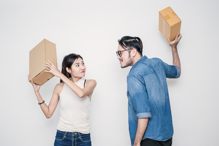 Man and woman fighting with boxes. Start up small business entrepreneur SME or freelance woman and man working with box, online marketing packaging box and delivery, SME concept