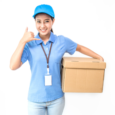 Portrait of happy delivery asian woman with cardboard box isolated on white background, young asian woman carry box gesture for phone calling, delivery service concept Reklamní fotografie