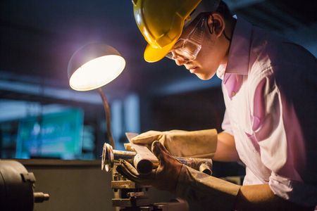 Heavy industry manual worker with grinder, man wearing mask with his hands grinding in heavy industry Stock Photo