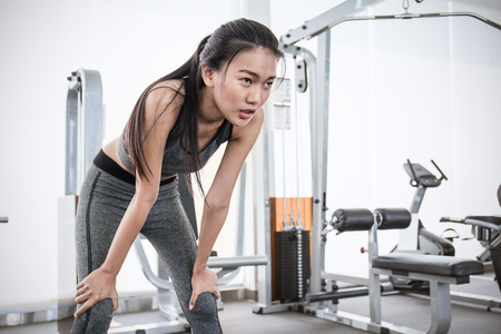 Portrait of Asian young beautiful woman  posting in the gym, asian woman work out  at the gym sport club