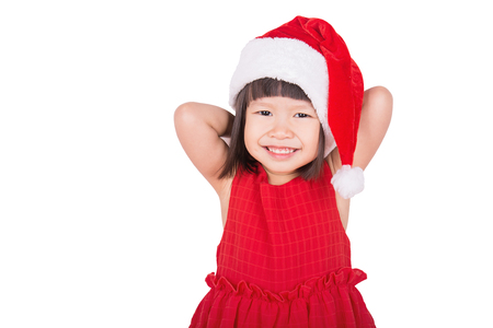 Portrait of little cute asian girl wearing red hat, christmas concept, little asian toddler celebrate xmas with her big smile.
