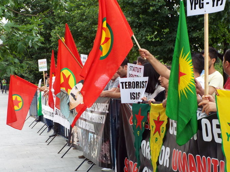 war crimes: Kurdish community protest in Bucharest, Romania for stop the crimes made by the terrorist group ISIS.
