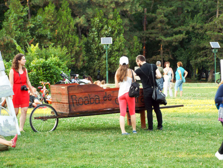 coming together: Culture wheelbarrow in Herastrau Park in Bucharest, Romania. Herastrau green space, lawn near the Seagull, has become a cultural hub for pedestrians, public known and public, over 200,000 people coming together in the gardens of the wheelbarrow culture in