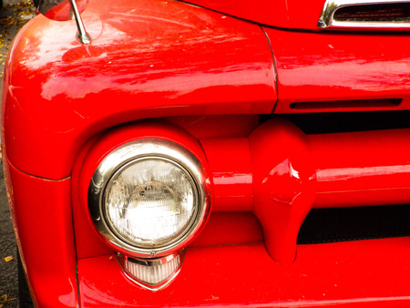 front bumper: closeup of the headlights and front bumper on a vintage car Stock Photo