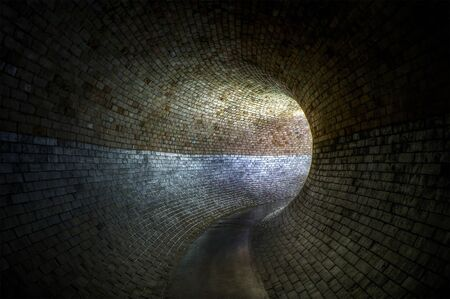 A large back light victorian sewer pipe Stock Photo