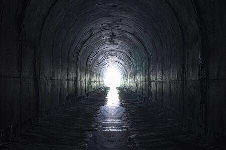 culvert: Dark arch leading towards light