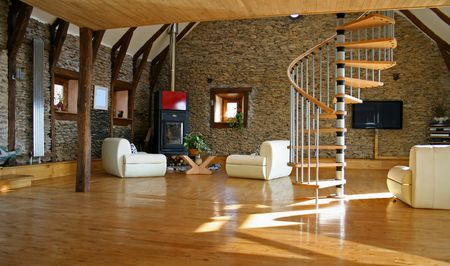 barn wood: stair case coming down into the living room with fireplace and television