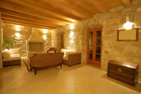 cottages: Luxury stone villa interior illuminated at night