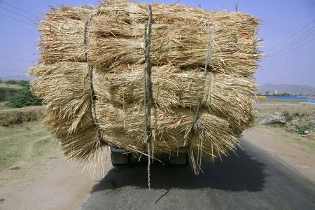 agriculture india: overloaded truck on highway, rajasthan, india Stock Photo