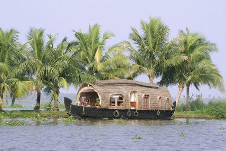 houseboat cruise through the backwaters, kerala, india photo