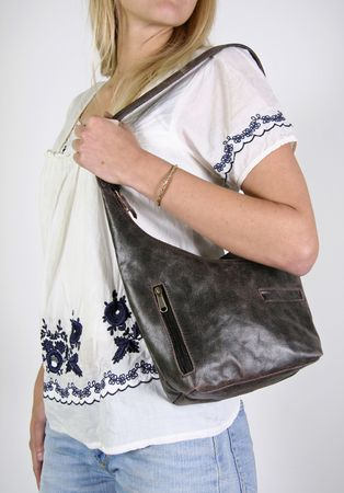 Woman posing with female hand bag photo