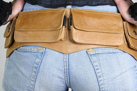 butt tight jeans: series: woman posing with money belt bag