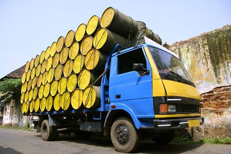 barrels stacked atop truck, south india photo