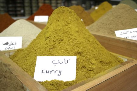mountain of curry on display in local spice store photo